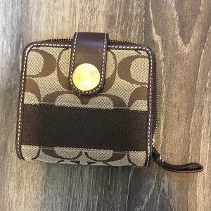 Brown Coach C pattern zipper wallet